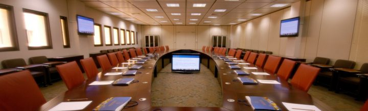 Boardroom with chairs around a table.